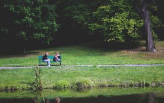 Assertive Message. An image showing two couple sitting in a bench while watching the lake