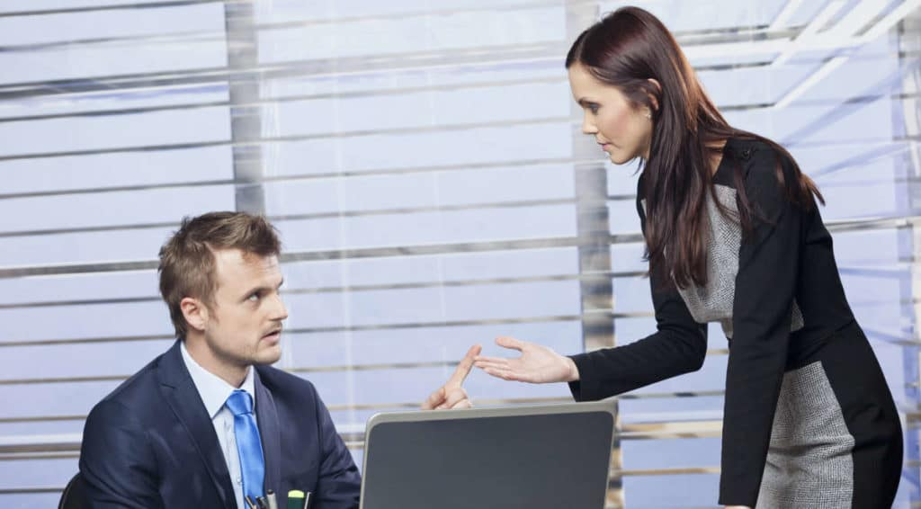 Confrontation - The 5 Basic Steps of Confrontation. An image showing a women confronting a man