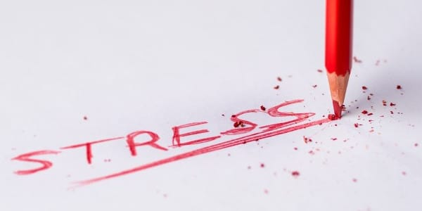 benefits of time management - stress written in red pencil
