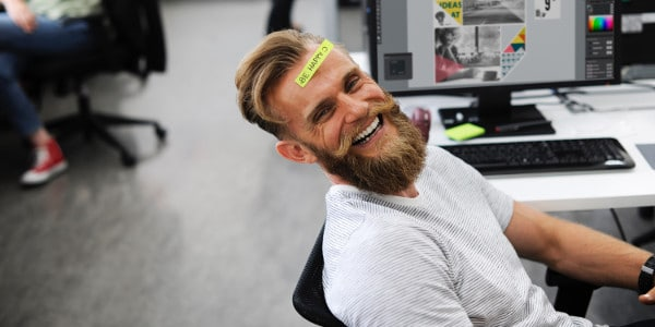 importance of time management - man smiling with sticky note on head that says be happy
