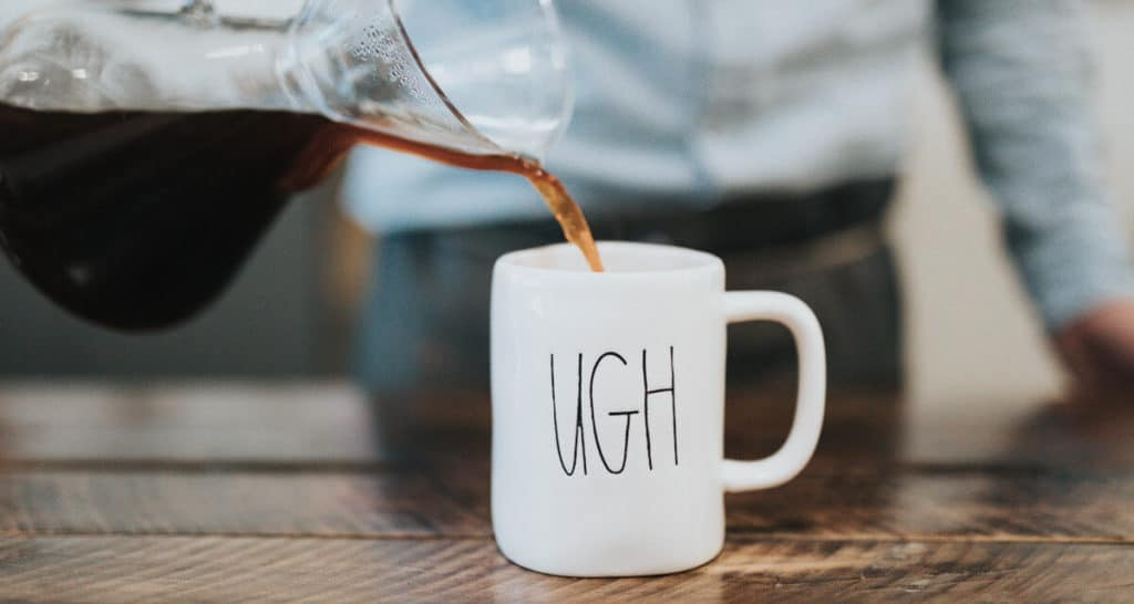 "stay motivated goal - man pouring coffee into coffee cup that says ""ugh"""