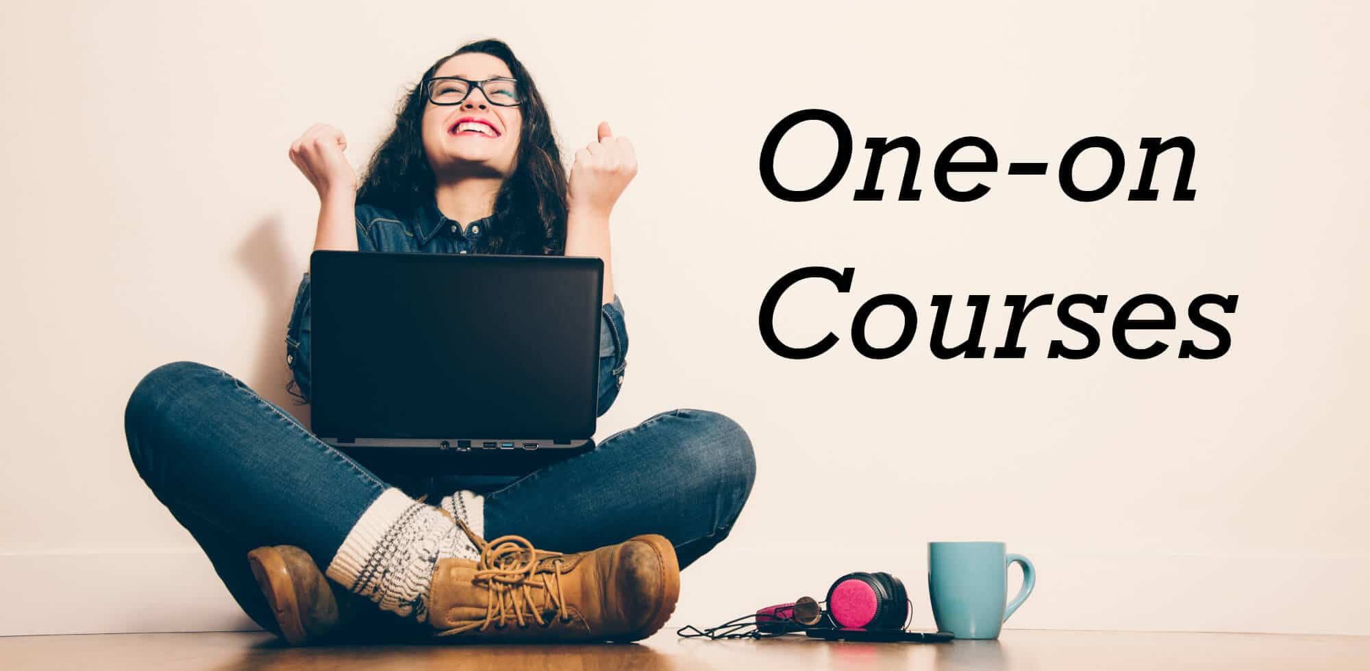 One-on Courses - woman excited holding laptop